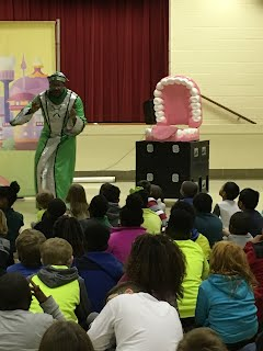 Tooth Wizard with student volunteers from the audience